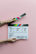 Woman Holding Clapperboard Ove...
