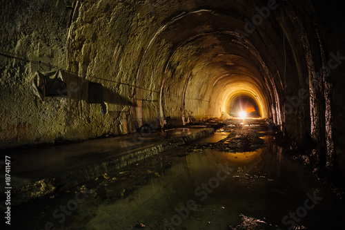 Foto op Aluminium Tunnel Old abandoned flooded drainage tunnel