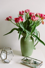 A Vase Of Pink Tulips And Glas...