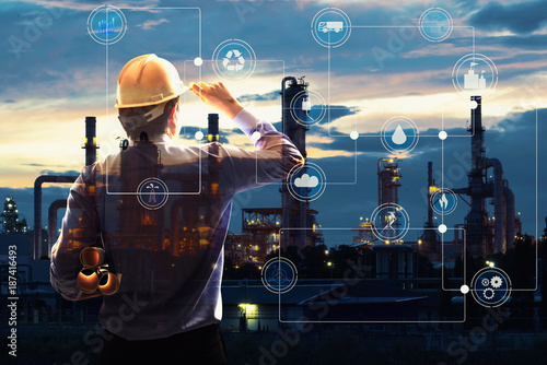 Fotografía  Double exposure of Engineer with oil refinery industry plant background,  industrial instruments in the factory and physical system icons concept, Industry 4