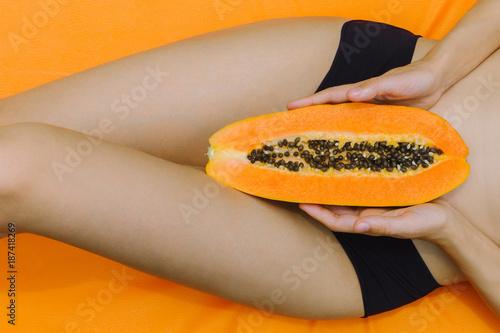 Woman lying with the papaya