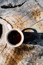 Cup Of Coffee On A Tree Stump