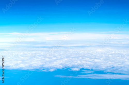 Keuken foto achterwand Turkoois Blue sky and Cloud Top view from airplane window,Nature background.