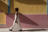 Beautiful Woman Walking Down The Street - 187420858