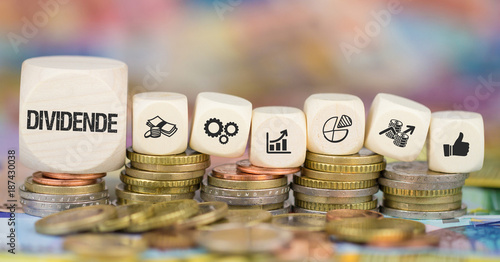 Cuadros en Lienzo Dividende / Münzenstapel mit Symbole