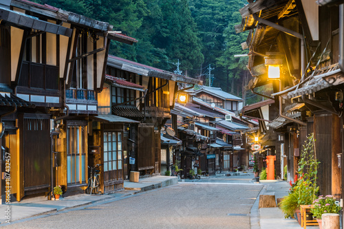 Narai-juku, Japan - September 4, 2017: Picturesque view of old Japanese town with traditional wooden architecture. Narai-juku post town in Kiso Valley, Japan