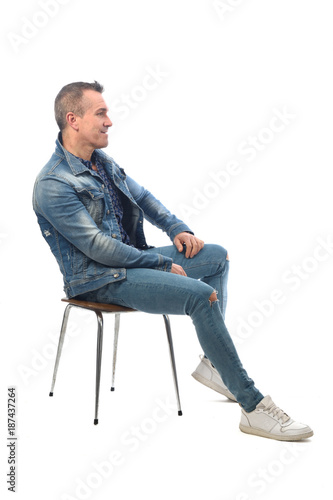 Obraz man sitting on a chair with white background - fototapety do salonu