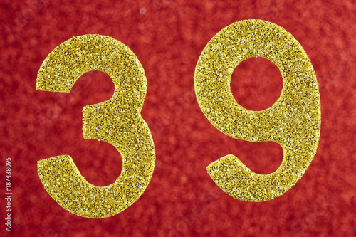 Poster Number thirty-nine gold color over a red background. Anniversary