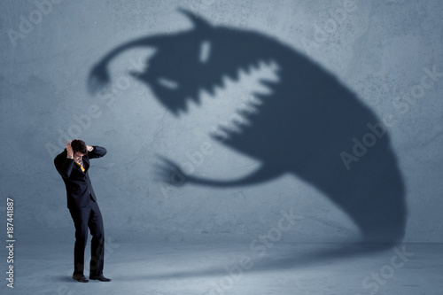 Business man afraid of his own shadow monster concept Wallpaper Mural