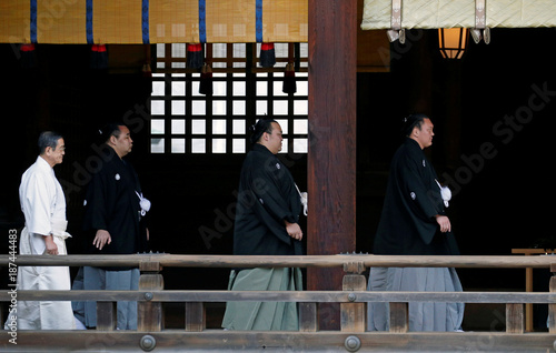 sumo champions walk to offer prayers before performing the new years ring entering rite at
