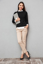 Full Length Image Of Pleased Asian Woman In Business Clothes