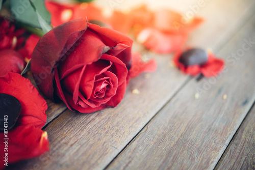 Spoed Fotobehang Rood, zwart, wit Red rose flower on wooden floor in Valentine's Day