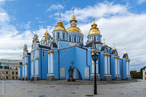 Foto op Plexiglas Kiev St. Michael's Monastery, blue walls, golden domes, white columns against the sky. michael s monastery kiev
