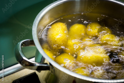 Fotografering  cooked potatoes in a pot