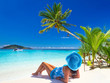 Beautiful woman in blue hat on the tropical beach