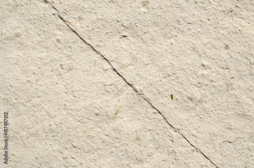 Natural color stone with a diagonal crack suitable for a background Wallpaper Mural