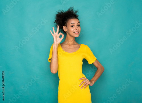 Fotografie, Obraz  Young beautiful woman showing ok sign