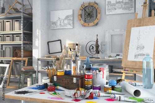 Künstlerische Ausstattung im Atelier mit einem Tisch voller Farben und Pinsel, im Hintergrund Gemälte, Regale und einer Staffelei aus Holz Canvas Print