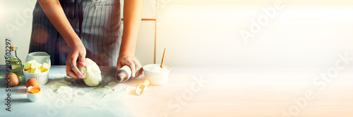 Recess Fitting Bread Female hands kneading dough, baking background. Cooking ingredients - eggs, flour, sugar, butter, milk, rolling pin on white style kitchen. Copy space. Banner