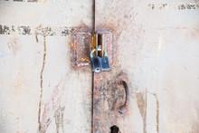 Closed Padlock On Steel Doors. The Locked Doors
