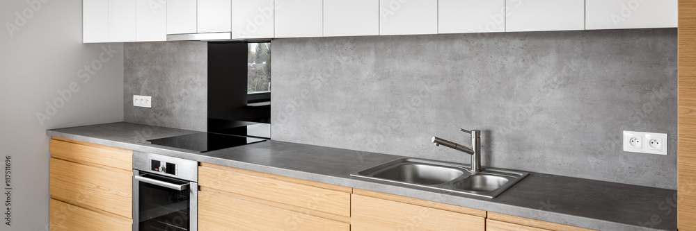 Fototapeta Modern kitchen furniture with induction