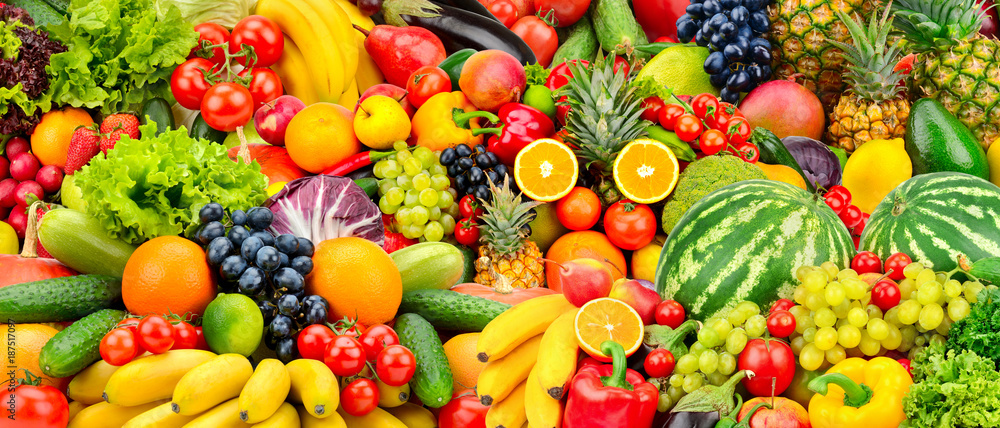 Assorted fresh ripe fruits and vegetables. Food concept background.
