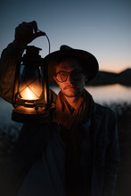 Man With Lantern In Evening