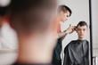 Hairstylist doing haircut