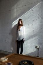 Young Woman Portrait In Loft