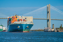 Container Ships Pass Under The Talmadge Memorial Bridge In Savannah, GA, USA
