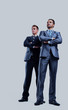 Two happy young businessmen full body, isolated on white.