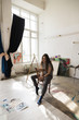 Young painter in her studio ,natural light