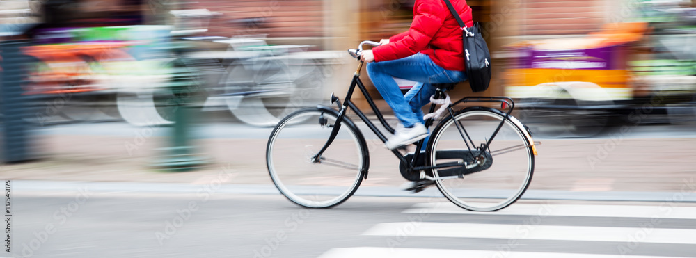 Fototapety, obrazy: bicycle rider in the city in motion blur