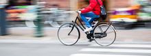 Bicycle Rider In The City In Motion Blur