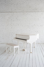 White Grand Piano In White Room