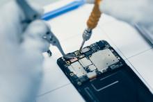 Man Repairing Smartphone.