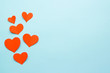 canvas print picture - red paper hearts on a blue background