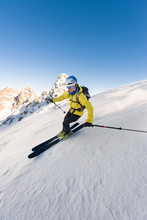 Man Skiing Downhill Steep Slope With High Speed