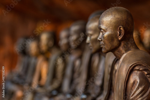 Buddhist monks statues symbol of peace and serenity at Wat Phu Tok temple, Thail Canvas Print