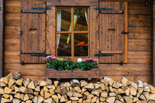 Wooden Mountain Hut With Window Decorated With Flowers