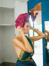 Female In Sari Wrapping Turban...