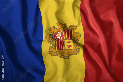 The Andorran flag is flying in the wind Canvas Print