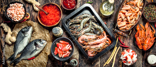 Photo  Different seafood with shrimps and red caviar.