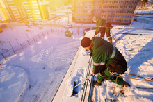 Snow Cleaning. Team Of Male Wo...