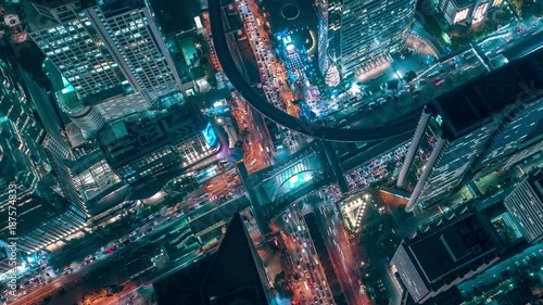 Time lapse,Hyperlapse ,Of traffic on city streets at night. Aerial view and top view of traffic on freeway, 4K. - 187574833