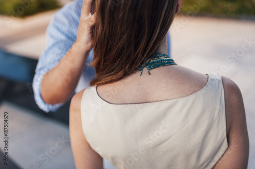 Man caressing the hair of his partner