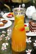 Bottle of fruit-tea on outdoors table