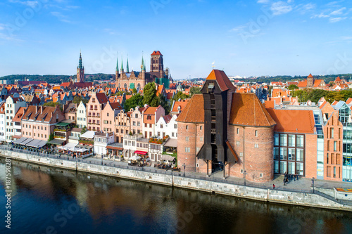 obraz dibond Gdansk old town in Poland with the oldest medieval port crane (Zuraw) in Europe, St Mary church, town hall tower and Motlawa River. Aerial view, early morning