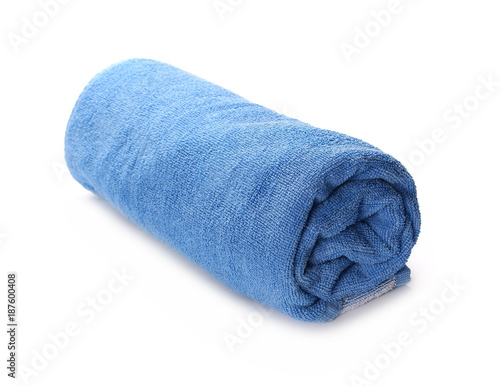 Fotomural Folded blue towel isolated on white background