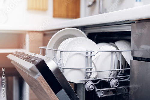 Fotografie, Obraz  open dishwasher with clean dishes at home kitchen